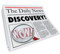 Discovery newspaper headline announcing surprising news the word on a with photo of magnifying glass on word wow to illustrate Royalty Free Stock Images