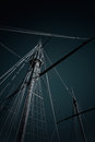 Discovery ship masts and rigging of a portuguese caravel from the time of toned black and white Royalty Free Stock Photography