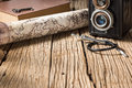 Discovery still life photography map camera shutter release cable key and book with space of old wood in concept Stock Image