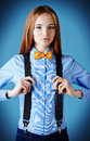 Discreet elegant girl model poses in blouse and bow tie fashion shot Stock Photos