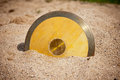 Discus throw disk in sand Stock Images