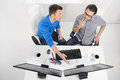 Discussing business plan top view of two businessmen dicussing something while one them pointing computer monitor Royalty Free Stock Photos