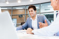 Discussion is the way to solution two businessman in office having Royalty Free Stock Photography
