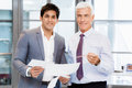 Discussion is the way to solution two businessman in office having Stock Images
