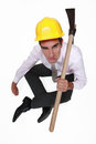 Disgruntled employee with a pickaxe Royalty Free Stock Image