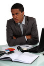 Disgruntled executive at his desk Royalty Free Stock Photos
