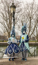 Disguised couple annecy france march unidentified posing near a canal during the annecy venetian carnival yearly in annecy france Stock Image