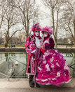 Disguised couple annecy france march unidentified in red costumes posing near a canal during the annecy venetian carnival yearly Royalty Free Stock Image