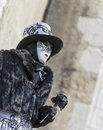 Disguised person annecy france february environmental portrait of an unidentified in a black costume holding a black rose in Royalty Free Stock Photography