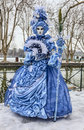 Disguised person annecy france february unidentified in a beautiful costume posing near a canal in annecy france during a venetian Stock Photography
