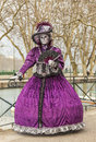 Disguised person annecy france march image of a posing near a water canal during the annecy venetian carnival yearly in annecy Royalty Free Stock Photo