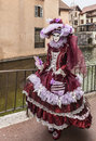 Disguised person annecy france march image of an unidentified posing near a canal during the annecy venetian carnival every year Royalty Free Stock Photo