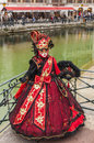 Disguised person annecy france march image of an unidentified posing near a canal during the annecy venetian carnival yealy in Stock Photography