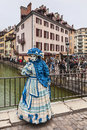 Disguised person annecy france march unidentified in a blue costume with a doll posing in front of a house during the annecy Royalty Free Stock Photos
