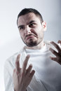 Disgusted researcher a young wearing a labcoat shocked or Stock Photo