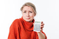Disgusted young woman holding a calculator for fear or maths Royalty Free Stock Photo