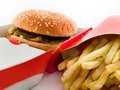 Disgusting Burger and Fries in Cardboard Royalty Free Stock Images