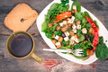 Dish of baby spinach salad with bread and tea Royalty Free Stock Images