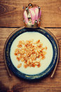 Dish of cereal with milk and hoop with crown Royalty Free Stock Photo