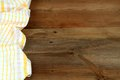 Dish cloth in yellow and white on brown wooden table Royalty Free Stock Photo
