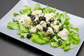 Dish of cod salad with black olives