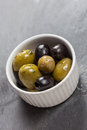 A dish of delicious black and green olives on slate background Stock Image