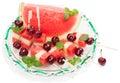 Dish with fresh fruit salad (watermelon, melon, cherries, min Royalty Free Stock Photo