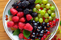 Dish of fresh seasonal berries Royalty Free Stock Photo