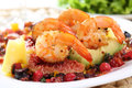 Dish of fried shrimps with avocato figs and berri berries sauce Royalty Free Stock Photo