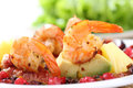 Dish of fried shrimps with avocato figs and berri berries sauce shallow dof Stock Image