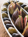 Dish of Green and Black Olives with Fresh Figs Stock Images