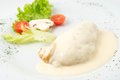 The dish of grilled chicken with cream souse and garnished on white plate white background Stock Images