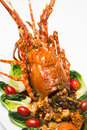 Dish of lobster roasted a luxury and decorated with many items vegetable Royalty Free Stock Photo