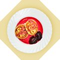 Dish of pancakes with cherry sause on white plate isolated image bckground view from above still life setout table Royalty Free Stock Photos