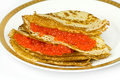 Dish with pancakes red caviar lying large plate of Royalty Free Stock Photos