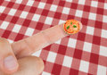 Dish with pizza margherita in miniature on the finger tablecloth red checkered pattern Royalty Free Stock Image