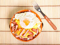 Dish polenta with bacon sausage and egg Stock Images
