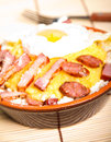 Dish polenta with bacon sausage and egg Royalty Free Stock Photo