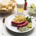 Dish with sausage and accompaniments Stock Photo