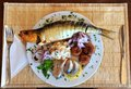 Dish with smoked herring and fish meat Royalty Free Stock Photo