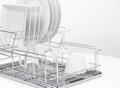 Dishes and glasses drying on metal dish rack Royalty Free Stock Photo