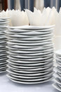 Dishes for party time close up stacks of white color Royalty Free Stock Photos