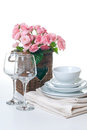 Dishes, towels and a basket of flowers Royalty Free Stock Images