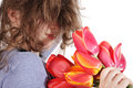 The disheveled girl with a bouquet of flowers Stock Images