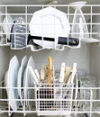 Dishwasher and Dirty Dishes Stock Photo