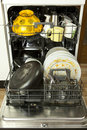 Dishwasher with filthy dishware opened Royalty Free Stock Photos