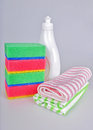 Dishwashing liquid and sponges bottle with washing towels Stock Images