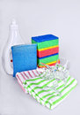Dishwashing liquid and sponges bottle with washing towels glasses Royalty Free Stock Photos