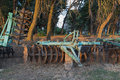 The disk harrow agricultural machinery for processing of soil in field Stock Image