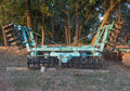 The disk harrow agricultural machinery for processing of soil in field Royalty Free Stock Photo